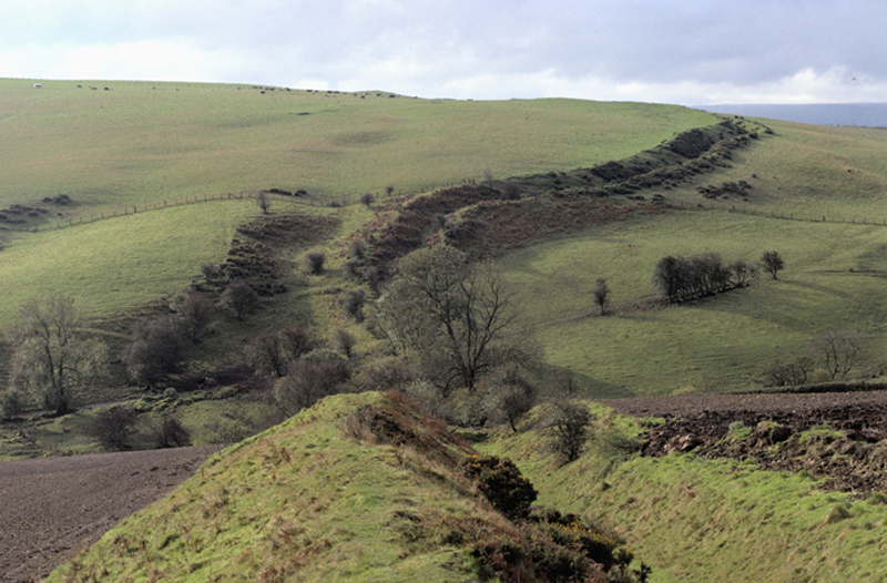 1990s, Near Knighton, Wales, UK --- Offa's Dyke near Knighton in Wales. The dyke was supposed to have been created by Offa the King of Mercia from 757 to 796 AD and roughly formed the boundary between England and Wales. --- Image by © Homer Sykes/CORBIS